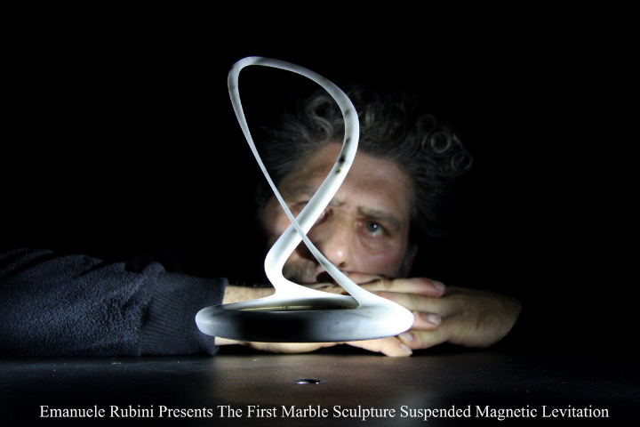 Emanuele Rubini presents the first sculpture suspended by magnetic levitation marble Carrara cm 22x15x15 press
