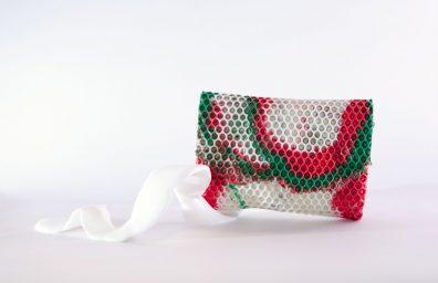 Enveloppez sac d'embrayage dans la conception de camouflage de polyuréthane rose Matteo Pellegrino