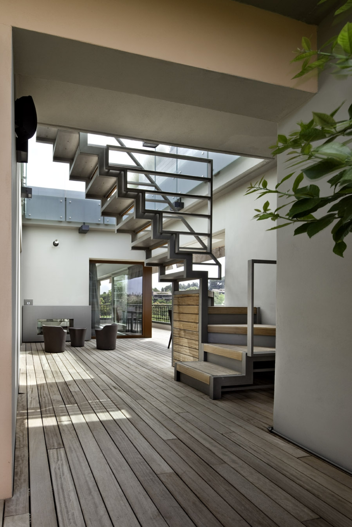 Redevelopment of an attic Roman Westway Architects, external staircase in painted steel